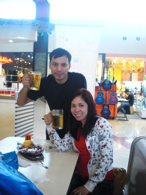Me and Raquel (sister-in-law), drinking at the Food Court